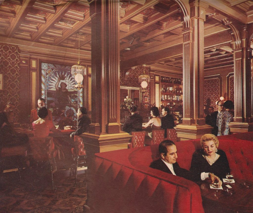 A 1960s photo of people socializing in the Victorian Room Lounge